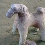 Horse statue worshipping tharu Deity